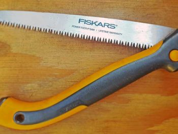 "A Fiskars brand hand saw in the open position in Spoken Garden's ""Best Pruning Saw"" tool review post."