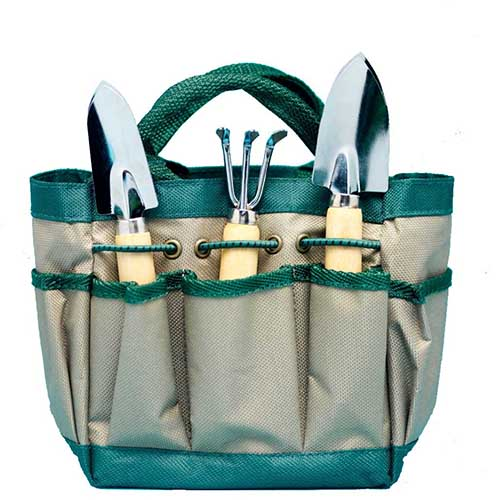 "A canvas bag holding 3 different garden hand tools in Spoken Garden's ""Best Garden Tool Sets"" tool review post."