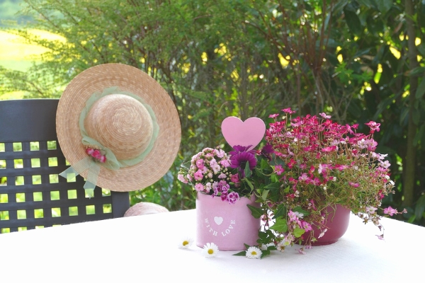 Gardening hat and Mother's Day flowers in Spoken Garden's DIY garden minute podcast