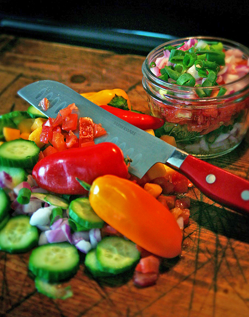 Various veggies and a kitchen knife advertising gardening gifts for Mother's day