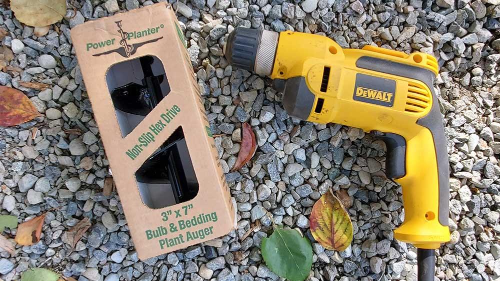 power planter bulb auger on gravel.