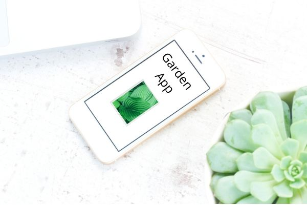 White Cell phone showing garden app